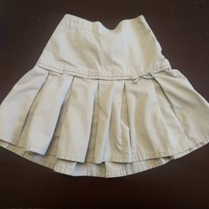 Girl's khaki pleated uniform skirt with bow.
